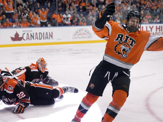 RIT's Todd Skirving, right, celebrates his second goal of the first period at the Blue Cross Arena at the Community War Memorial on Oct. 17, 2015.