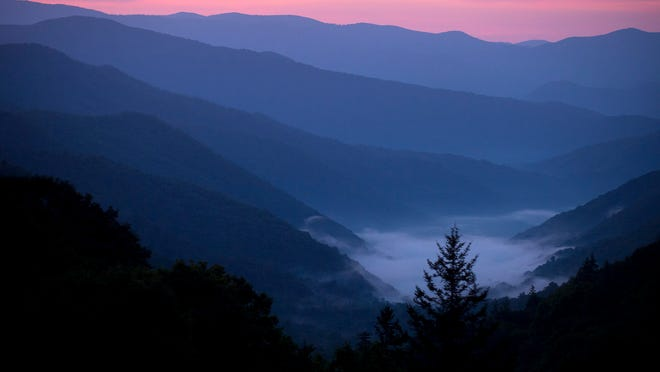 Early-morning fog fills a valley outside Cherokee, N.C., as seen from an overlook along Highway 441 last week in the Great Smoky Mountains National Park.