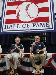 Dick Enberg, right, received the Ford C. Frick Award last July at the Baseball Hall of Fame in Cooperstown, N.Y. Former Detroit News sports writer Tom Gage, left, received the J.G. Taylor Spink Award.