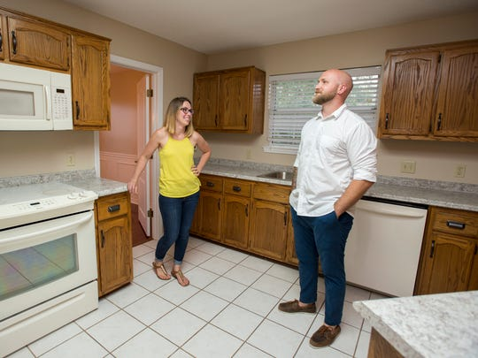 First-time homebuyers Jaime and David Gibbs do the final walk-through on the house that they are purchasing in Pace on Tuesday, Aug. 8, 2017.