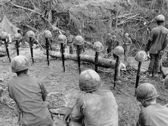 Members of the U.S. Army 101st Airborne Division mourn