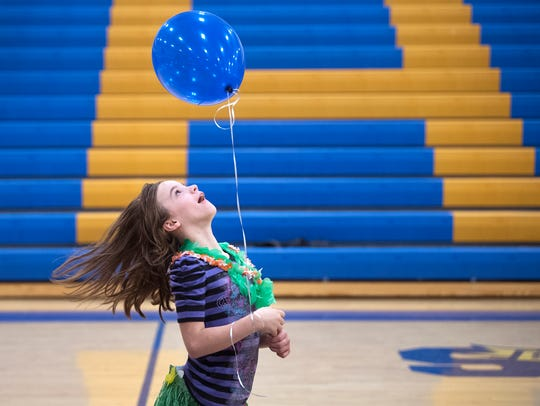 Keira Tittle, 10, spins with her balloon Wednesday,