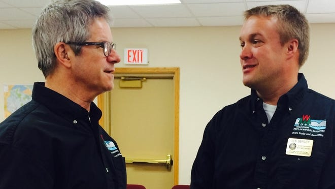 Peter Biermeier (left), Recreation, Planning and Development Section chief for the DNR's Bureau of Parks and Recreation, talks to Ben Bergey, DNR's Northwest Park and Trail supervisor after meeting with Rib Mountain's town leaders on March 18, 2015.