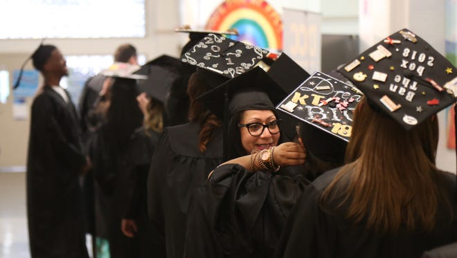Scenes from Thursday's commencement ceremony for Ridley Lowell students at the Family Partnership Center in the City of Poughkeepsie on June 14, 2018. The commencement ceremony was organized by the community for students who completed their studies before the school closed abruptly in April.