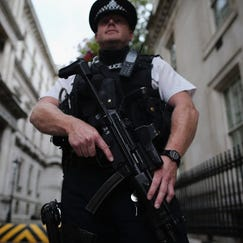 A police officer stands in Downing Street on Aug. 29 in London.