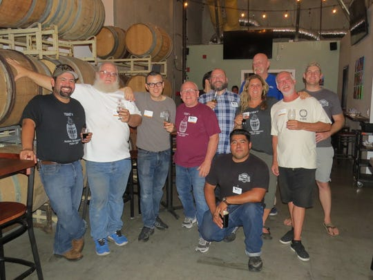 Members of the homebrewing group VIBE, or Ventura Independent Beer Enthusiasts, gather for a group photo at the Pure InFATuation Brew Competition in Oxnard. The contest featuring beers made with full advanced treated (FAT) recycled water resulted in a tie for first place by Andy Carter, third from left, and Georgia Flair, fourth from right.