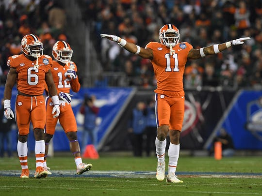 Clemson safety Isaiah Simmons (11) reacts after a defensive stop against Miami during the 1st quarter of the ACC championship game against Miami at Bank of America Stadium in Charlotte on Saturday, December 2, 2017.