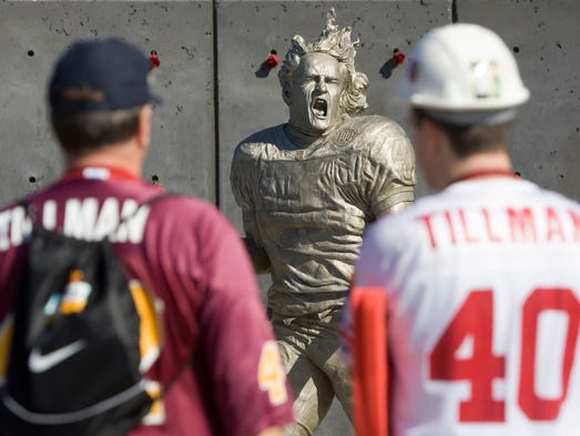 Nov. 12, 2006 - Fans stop to look at a statue of Pat Tillman near gate No. 2 at University of Phoenix Stadium in Glendale.