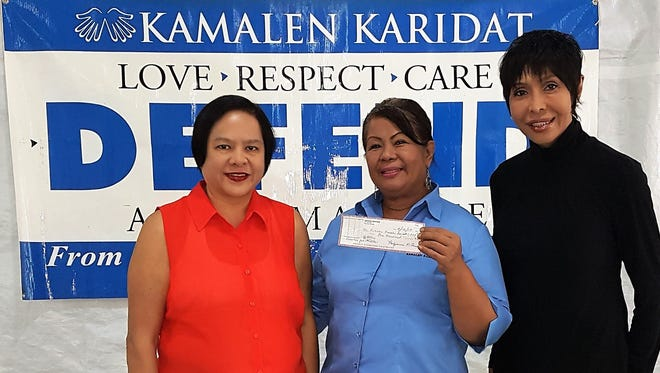 Crimosona A. Kaiser and Pollyanna Amistad, Owners of Amistad Rentals, presented a check to Kamalen Karidat, on Sept. 12 to assist in the feeding of our homeless brothers and sisters. Pictured from left: Pollyanna Amistad, Doris Royal, Program Director, Crimsona A. Kaiser.