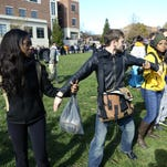 People form a human chain to keep journalists out after University of Missouri student Jonathan Butler ends his hunger strike Nov. 9 after the resignation of Univeristy of Missouri System President Tim Wolfe.