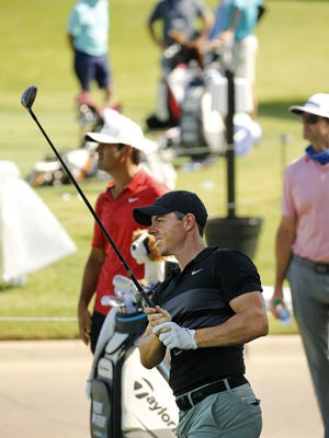PGA golfer Rory McIlroy tees off during the Charles Schwab Challenge practice round at the Colonial Country Club in Fort Worth, Texas on Tuesday.