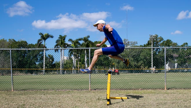 Roger Vergin, 80, works on hurdles at Shady Oaks Park on Wednesday. Vergin runs in USA Track and Field Masters track meets competing in the decathlon, pentathlon, pole vault, long jump, triple jump, hurdles and sprint relays. He has won scores of medals in the 10 years he has been competing.