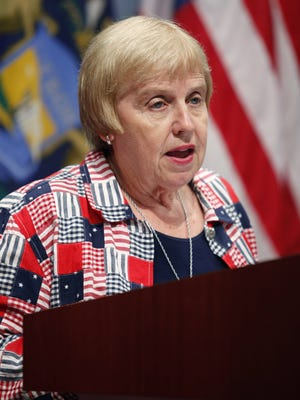 Michigan Supreme Court Justice Elizabeth Weaver speaks during a news conference in 2010. highest court on Thursday following the resignation of Justice Weaver. Weaver's death was confirmed Wednesday.  She was 74.
