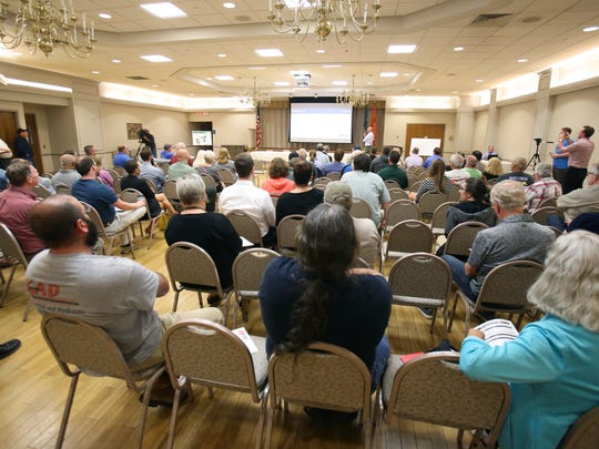 Attendees listen during an information meeting hosted by Harvey Hanna & Associates, Inc. and local officials to update the public on progress and plans for reutilizing the Boxwood Road assembly plant site Tuesday at the Five Points Fire Company hall.