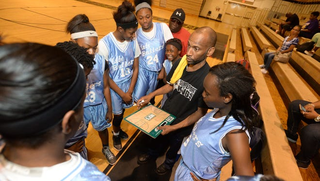 Cedric Redd gets his Shreveport Lady Ballers fired up before their summer league game with the Lady Knicks.;
