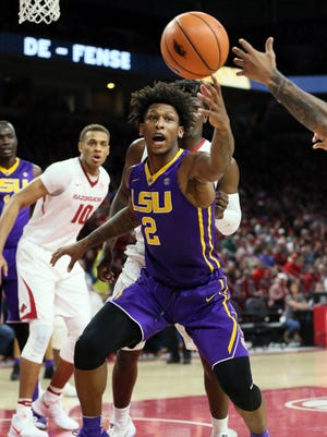 LSU Tigers guard Brandon Rachel (2) reaches for a loose ball in the first half against the Arkansas Razorbacks at Bud Walton Arena.
