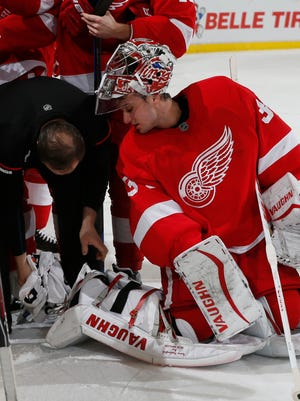 Red Wings goalie Petr Mrazek has his skates attended to during a time-out in the first period of  the 2-1 shoot-out loss to the Senators Tuesday at Joe Louis Arena.