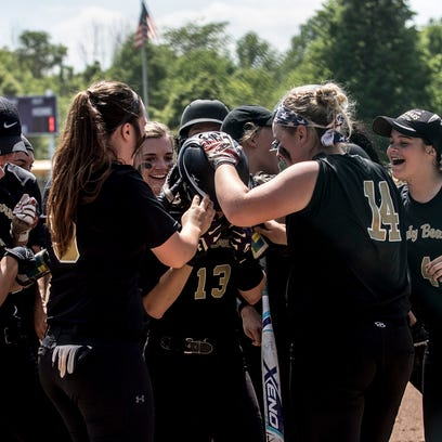 River View players run to home plate to greet teammate