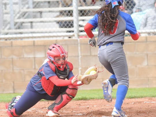 Lubbock Monterey catcher Remington Martin, left, lunges