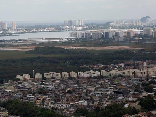 "Homes in the favela ""Cidade de Deus,"" or City of God, stand near the newly built Olympic Park, center right, in Rio de Janeiro, Brazil."