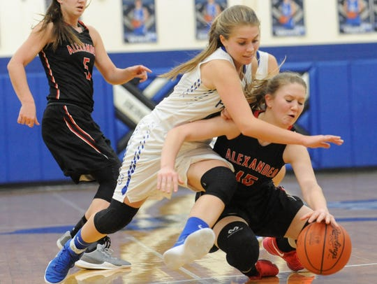 Southeastern's McKinley Mitten fights for possession