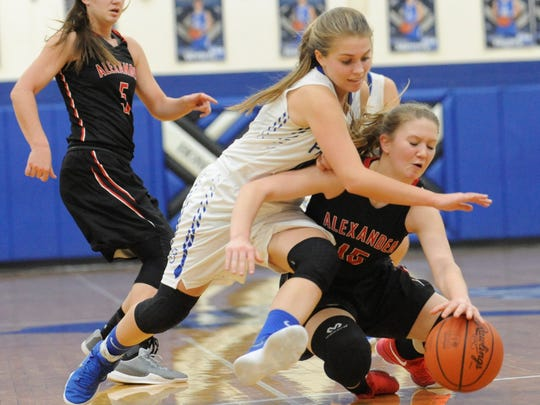 Southeastern's McKinley Mitten fights for possession of the basketball with Alexander's Rachel Richardson. Mitten's Panthers beat Richardson's Spartans by a 47-44 final, Wednesday.