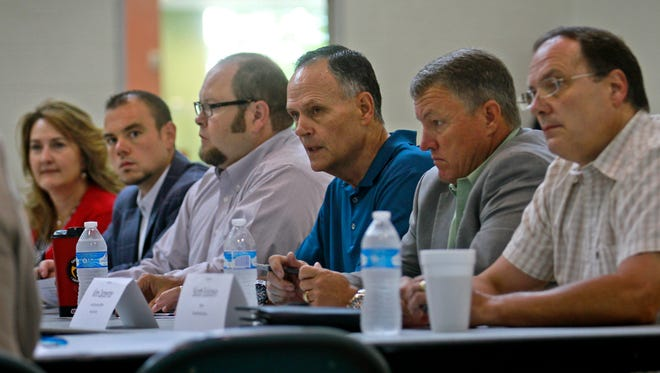 From left, Farmington City Council members  Linda Rodgers, Sean Sharer and Nate Duckett, Farmington Mayor Tommy Roberts, San Juan County Chief Executive Officer Kim Carpenter and city of Bloomfield Mayor Scott Eckstein participate in a Gold King Mine meeting on Tuesday at the Sycamore Park Community Center in Farmington.