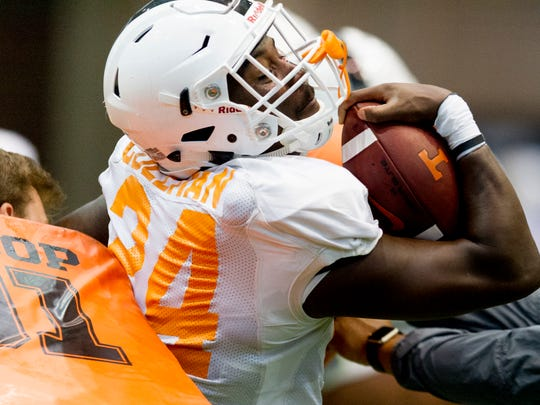 Tennessee's running back Trey Coleman (24) runs through a drill during Tennessee fall football practice at Anderson Training Facility in Knoxville, Tennessee on Friday, August 4, 2017.
