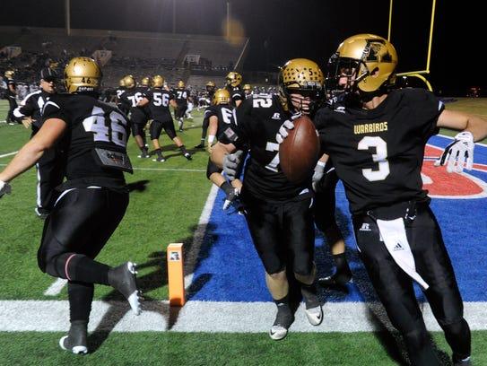 Abilene High's Kallin Sipe (right) celebrates a touchdown