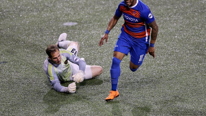 FC Cincinnati midfielder Emery Welshman (10) beats the keeper but his touch is too long in the second half during the USL soccer game between Atlanta United 2 and FC Cincinnati, Saturday, May 5, 2018, at Nippert Stadium in Cincinnati. FC Cincinnati won 4-2.