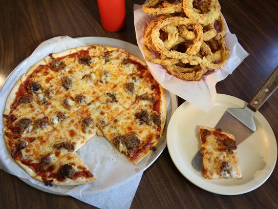 A meatball pizza with onion rings at Bordenaro's.