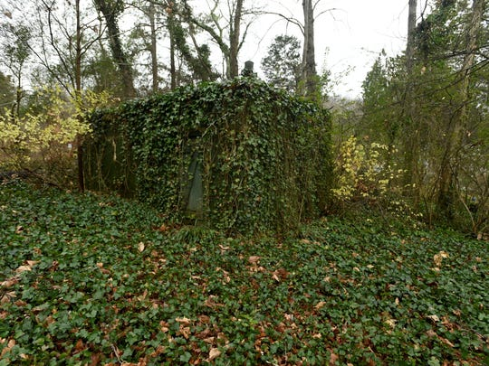 In this photo taken Dec. 22, 2014, a bomb shelter is covered in ivy behind the home built in 1958 by the architect of the United States' rocket program during the early years of the space race, Wernher Von Braun, which is on the market in Huntsville, Ala. Real estate agent Julie Lockwood said the house carries such historic appeal she could not miss the chance to sell it. (AP Photo/Eric Schultz, AL.com)