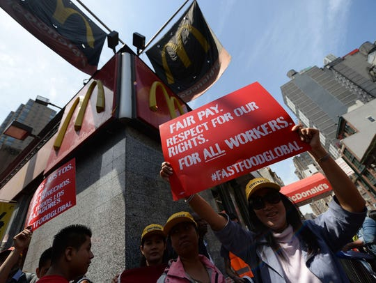Fast-food workers from around the world stage a protest