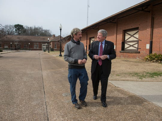 John McAfee, left, talks with Opelika Mayor Gary Fuller.