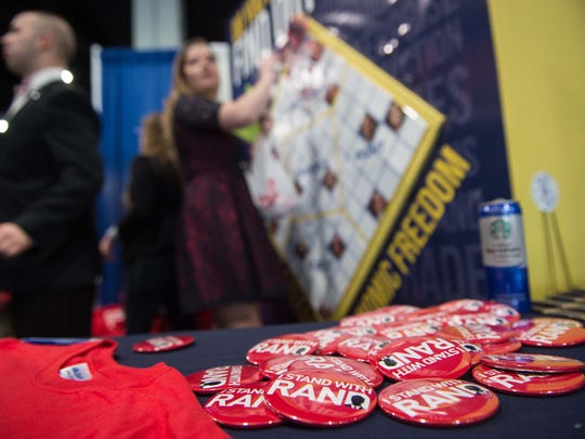 Supporters of Sen. Rand Paul work at a stand at the