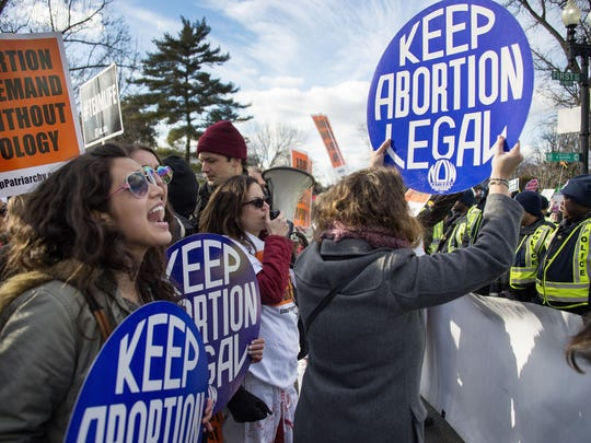 Pro-choice activists block the road against US Capitol