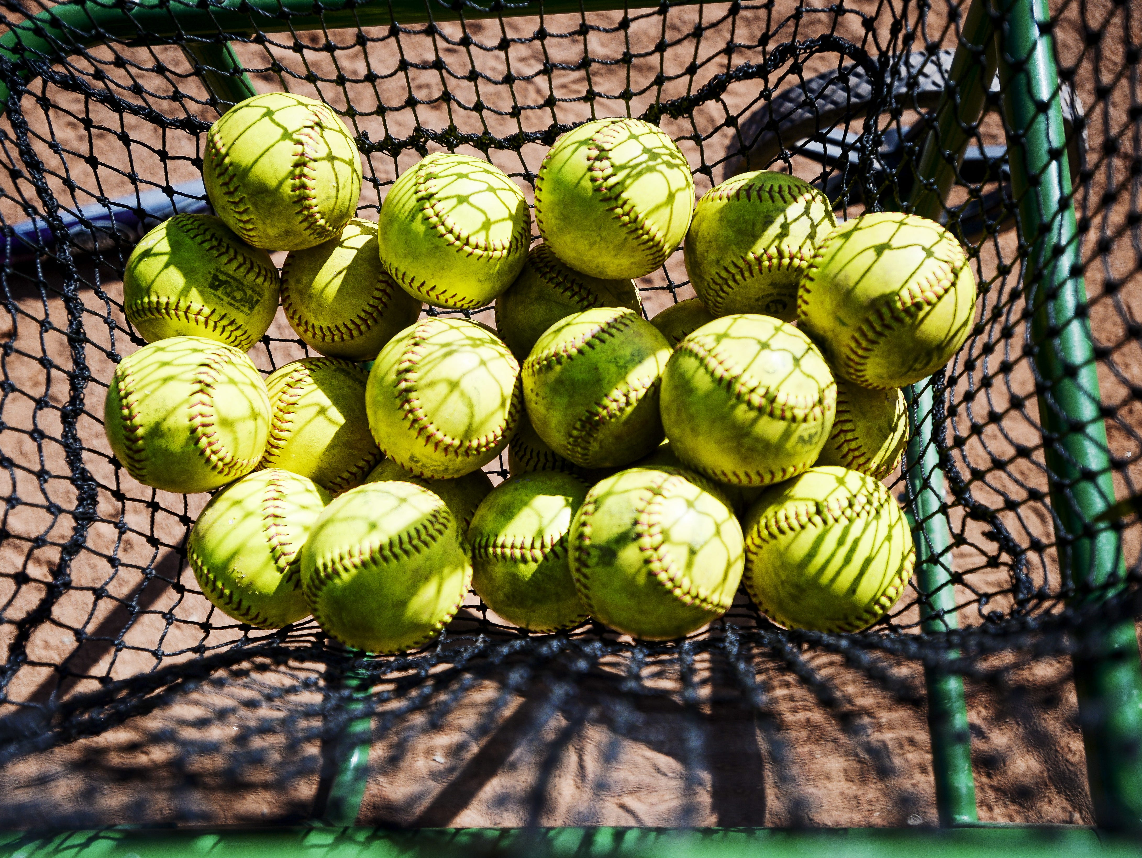 Softballs sit at the CSU softball practice Wednesday, March 19, 2014, at Ram Field.
