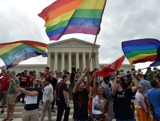 People celebrate outside the Supreme Court on June
