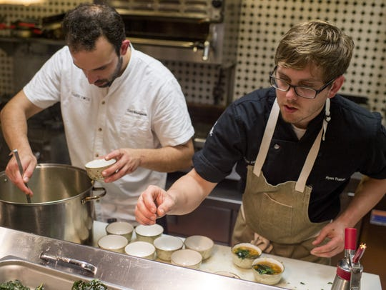 Chefs Cory Bourgeois and Ryan Trahan fill bowls with