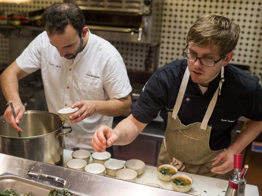 Chefs Cory Bourgeois and Ryan Trahan fill bowls with egg drop soup in this Advertiser file photo.