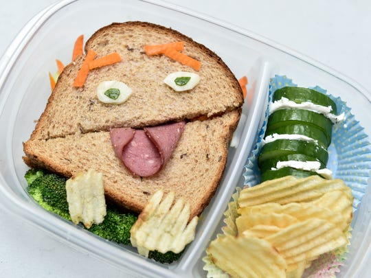 A silly salami sandwich on a broccoli bed lightens the lunchtime mood while providing a healthy serving of vegetables.