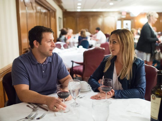 Gabriel Camalo and Michelle Camalo converse over dinner