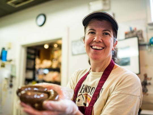 Lori Walls holds several links of boudin at Johnson's Boucaniere in Lafayette, La., Tuesday, Sept. 29, 2015.