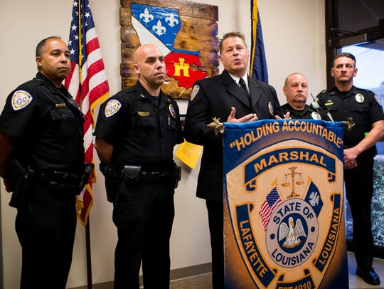 Lafayette City Marshal Brian Pope speaks during a press