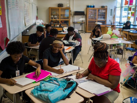 Students converse during a class project at Northside
