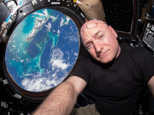 NASA astronaut Scott Kelly, seen here on July 12 in the International Space Station's Cupola, has now spent more time in space than any American.