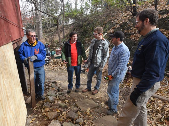 Make a Difference Day Volunteers, from left, Tom Cramer of Hopewell Junction, House Captain Keegan Trott of Peekskill, Josh Fagnant of Mahopac, Javier Herrera of Danbury, Connecticut, and Bruce Fields of Washingtonville discuss their work at a home in Pleasant Valley on Saturday.
