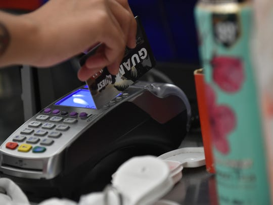 A cashier swipes a card for the Supplemental Nutrition