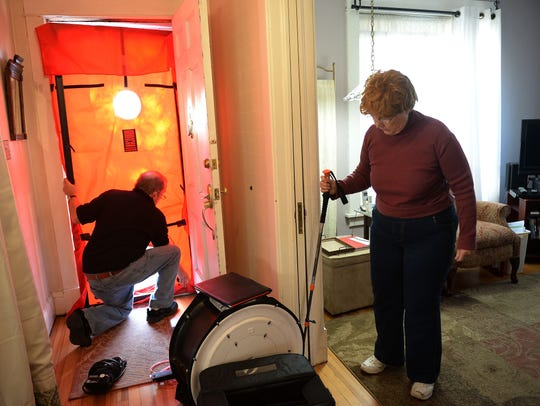 Mark Fagerburg installs a blower door to test for air