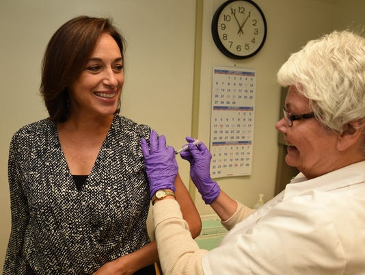 Dr. Karen DeSalvo receiving her flu shot.